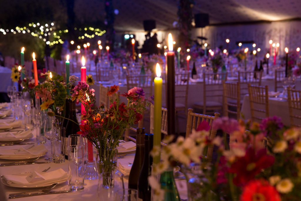 Guinness marquee night flowers candles
